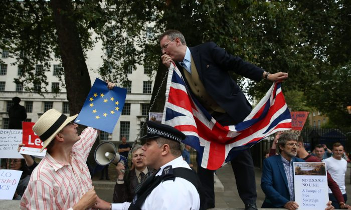 A  police  officer  separates  an  anti-Brexit  demonstrator  from  a  pro-Brexit  demonstrator  in  Parliament  Square  on  September  3rd,  2016.   The prospect of a 'hard Brexit' – an all-out exit from the European Union – is looking likely, business leaders say. (JUSTIN TALLIS/AFP/Getty Images)