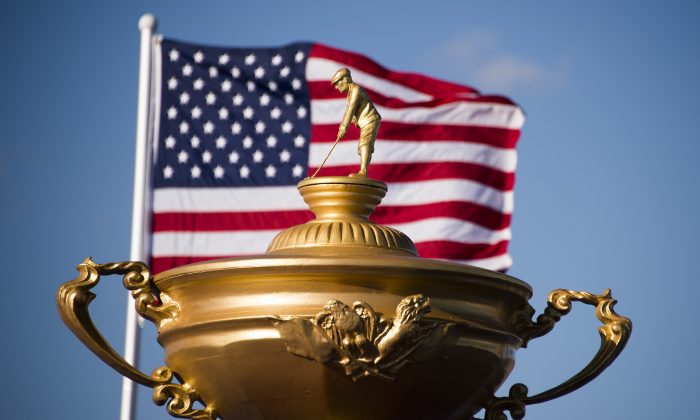 The American flag flies behind a statue of the Ryder Cup trophy at Hazeltine National Golf Course in Chaska, Minnesota. (Jim Watson/AFP/Getty Images)