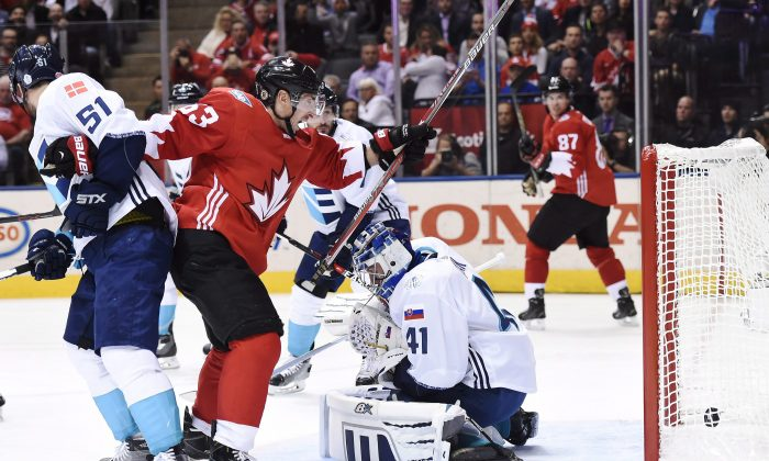 Team Canada's Brad Marchand and Sidney Crosby celebrate Patrice Bergeron's goal while Team Europe's Frans Nielsen looks on during WorldCupofHockeyfinals action in Toronto on  Sept. 27, 2016. (The Canadian Press/Nathan Denette)