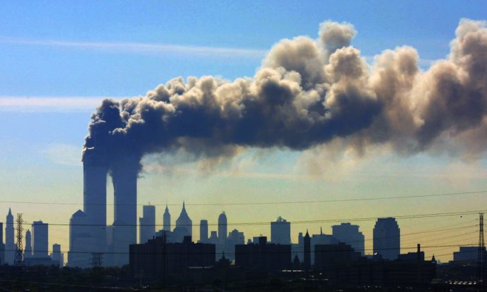 Smoke billows from the twin towers of the World Trade Center in New York  on Sept. 11, 2001.  Saudi Arabia and its allies are warning that legislation allowing the kingdom to be sued for the 9/11 attacks will have negative repercussions.  (AP Photo/Gene Boyars)