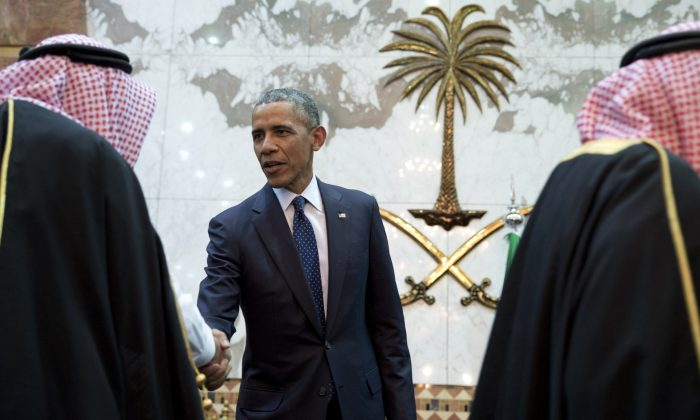 In this Jan. 27, 2015 file photo, President Barack Obama participates in a receiving line with the Saudi Arabian King, Salman bin Abdul Aziz, at Erga Palace in Riyadh, Saudi Arabia. Saudi Arabia and its allies are warning that legislation allowing the kingdom to be sued for the 9/11 attacks will have negative repercussions. The kingdom maintains an arsenal of tools to retaliate with, including curtailing official contacts, pulling billions of dollars from the U.S. economy, and enlisting its lockstep Gulf allies to scale back counterterrorism cooperation, investments and U.S. access to important regional air bases.(AP Photo/Carolyn Kaster, File)