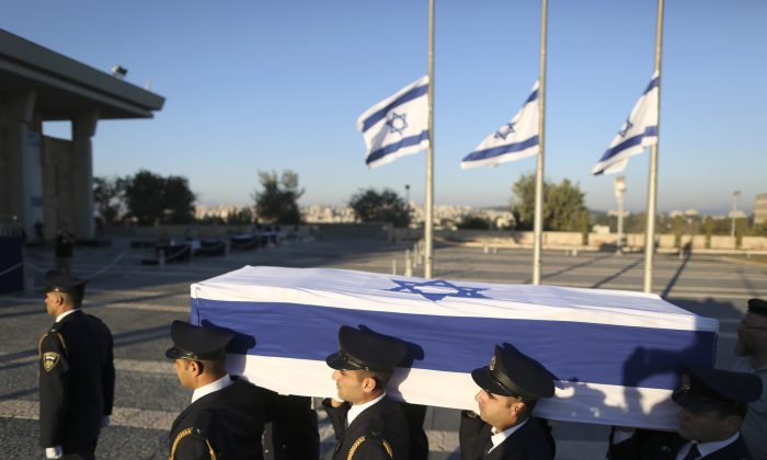 Members of the Knesset guard carry the coffin of former Israeli President Shimon Peres at the Knesset plaza in Jerusalem on Sept. 29, 2016. (AP Photo/Oded Balilty)