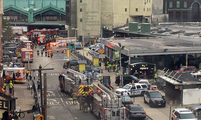 Emergency personnel arrive at the scene of a train crash in Hoboken, N.J. on Thursday, Sept. 29, 2016. (AP Photo/Joe Epstein)