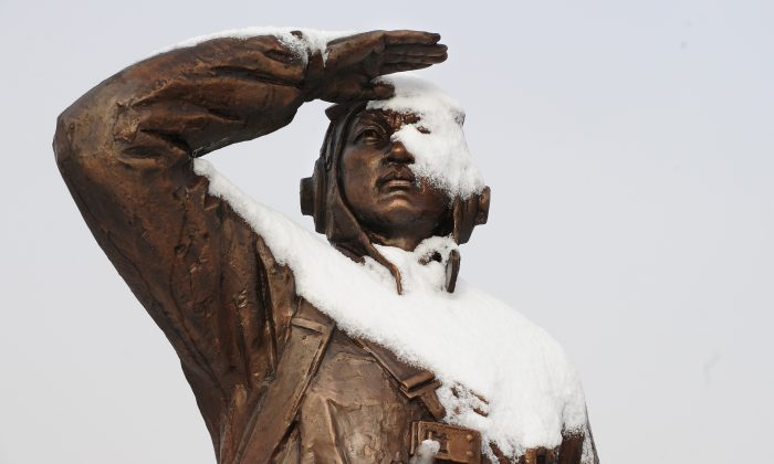 "A monument dedicated to a Chinese war veteran looking towards North Korea the banks of the Yalu River in Dandong is patially covered in snow on November 27, 2010 in northeast China's Liaoning province, across from North Korean border town of Siniuju which is connected by the Sino-Korean Friendship Bridge after a night of snowfall. The United States has sought to reassure China over joint US-South Korean military exercises, with the Pentagon insisting the war games were ""not directed"" at Beijing with the four-day exercises starting November 28 coming in the wake of North Korea's artillery bombardment of a South Korean island.  AFP PHOTO / Frederic J. BROWN (Photo credit should read FREDERIC J. BROWN/AFP/Getty Images)"
