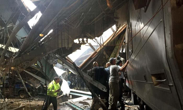 Train personel survey the NJ Transit train that crashed in to the platform at the Hoboken Terminal New Jersey on Sept. 29. (Pancho Bernasconi/Getty Images)
