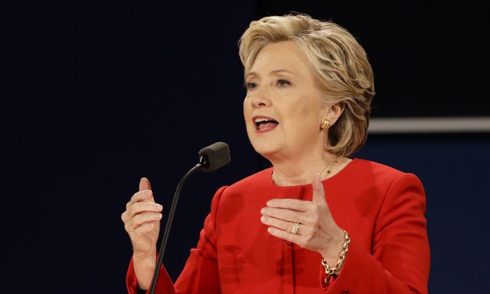 Democratic presidential candidate Hillary Clinton answers a question during the presidential debate with Republican presidential candidate Donald Trump at Hofstra University in Hempstead, N.Y., on Sept. 26, 2016. (AP Photo/David Goldman)