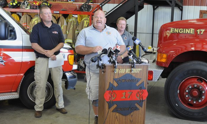Fire Chief Billy McAdams, center, speaks with reporters about a school shooting during a news conference in Townville, S.C., on Thursday, Sept. 29, 2016. McAdams was among the first two officials to arrive on the scene of the shooting, which injured two students and a teacher at a rural elementary school. (AP Photo/Jay Reeves)