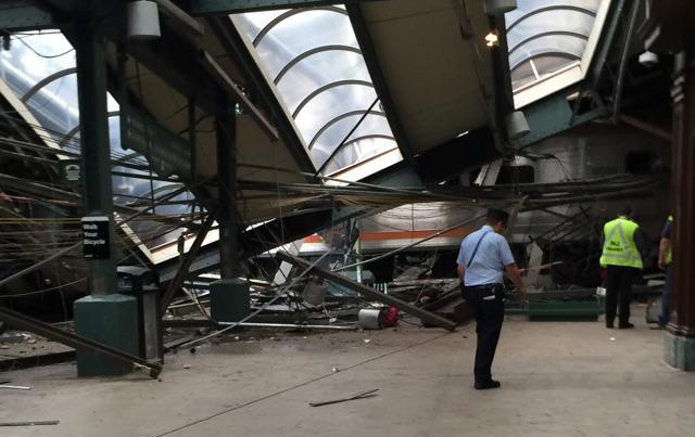 This photo provided by a passenger who was on the train when it crashed shows wreckage at the Hoboken, N.J. rail station on Sept. 29, 2016. (AP Photo)