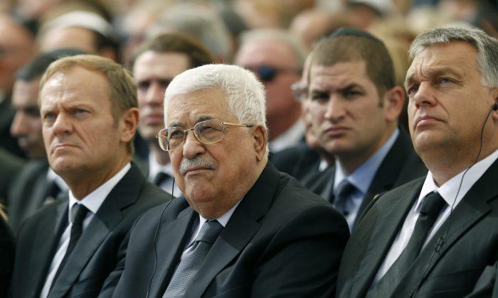 Palestinian President Mahmoud Abbas (C) sits alongside European Council President Donald Tusk (L) at the funeral of former Israeli President Shimon Peres, 93, on Mt. Herzl Cemetery in Jerusalem on Sept. 30, 2016. (Abir Sultan, Pool via AP)