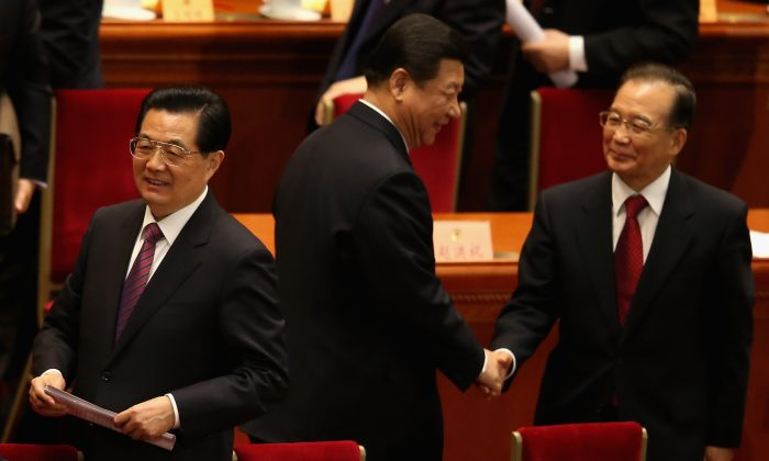 Former Chinese premier Wen Jiabao (C) walks past former Chinese leader Hu Jintao (L) and the current leader Xi Jinping (R) at the closing session of the rubber-stamp legislature's congress in Beijing, China on March 17, 2013. (Feng Li/Getty Images)