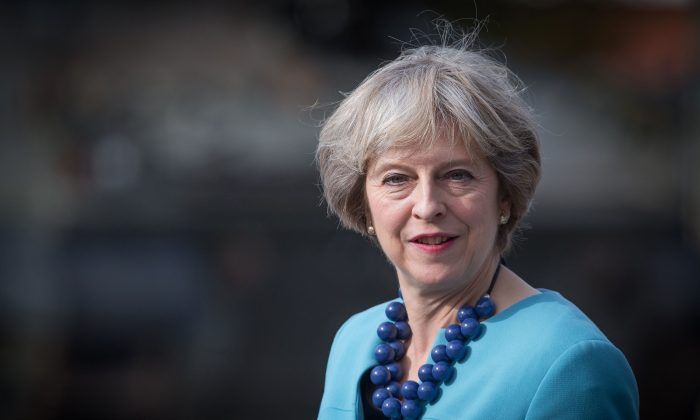 Britain's Prime Minister Theresa May reacts visits the 1st Battalion The Mercian Regiment at their barracks at Bulford Camp near Salisbury, southwest England, on Sept. 29, 2016. (Matt Cardy/AFP/Getty Images)