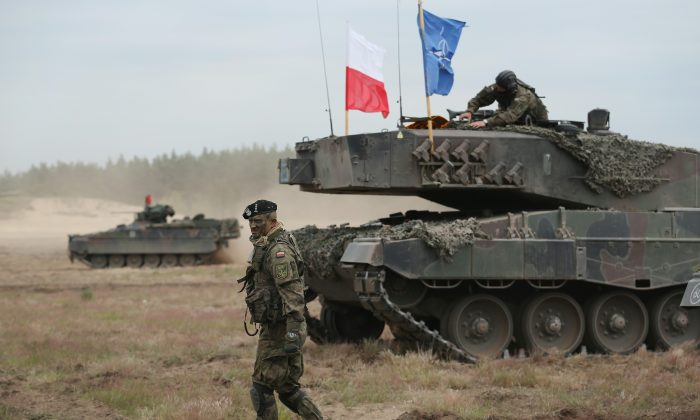 Tanks of the Polish and German armed forces participate in the NATO Noble Jump military exercises in Zagan, Poland, on June 18. (Sean Gallup/Getty Images)