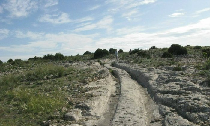 Wheel ruts in stone, in Castellar de Meca, Spain. (Courtesy of Dr. Alexander Koltypin)