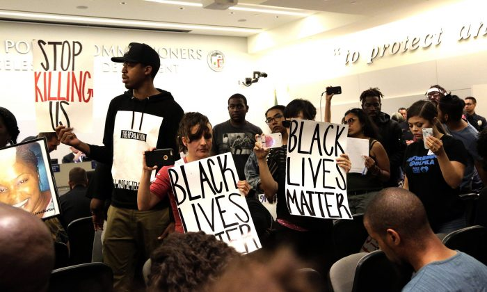 """Activists hold """"Black Lives Matter"""" signs in a file photo. (AP Photo/Nick Ut)"""
