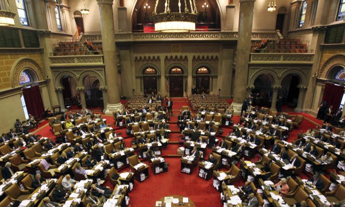 Members of the New York State Assembly at the Capitol in Albany, N.Y., on June 23, 2011.  (AP Photo/Mike Groll)