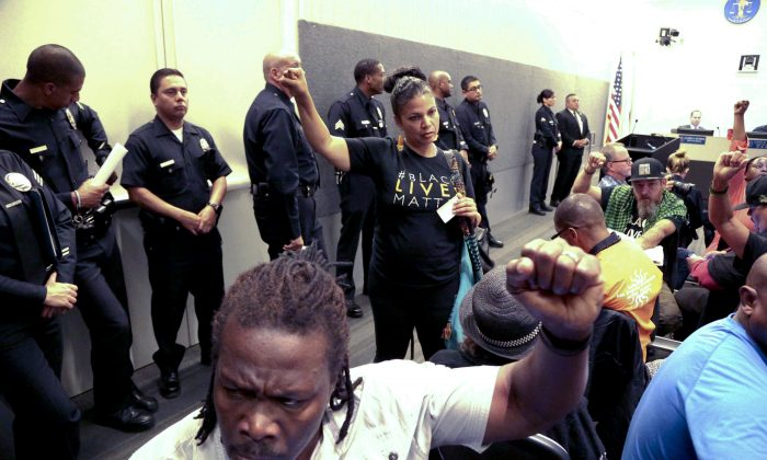 Black Lives Matter protesters demonstrate inside the board of Police Commissioners meeting in Los Angeles on Oct. 4, 2016. Police released surveillance video showing an 18-year-old black suspect running from police while holding what appears to be a gun in his left hand just before he was fatally shot by officers in a death that has generated protests. (AP Photo/Nick Ut)