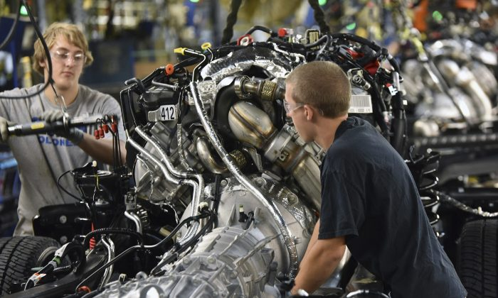 In this Sept. 30, 2016, photo, United Auto Workers assemble a 2017 Ford F-Series Super Duty truck at the Kentucky Truck Plant in Louisville, Ky. On Friday, Oct. 7, 2016, the U.S. government issues the September jobs report. (Sam VarnHagen/Ford Motor Co. via AP)