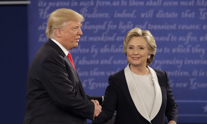 Republican presidential nominee Donald Trump shakes hands with Democratic presidential nominee Hillary Clinton during the second presidential debate at Washington University in St. Louis on Oct. 9, 2016. (John Locher/AP Photo)