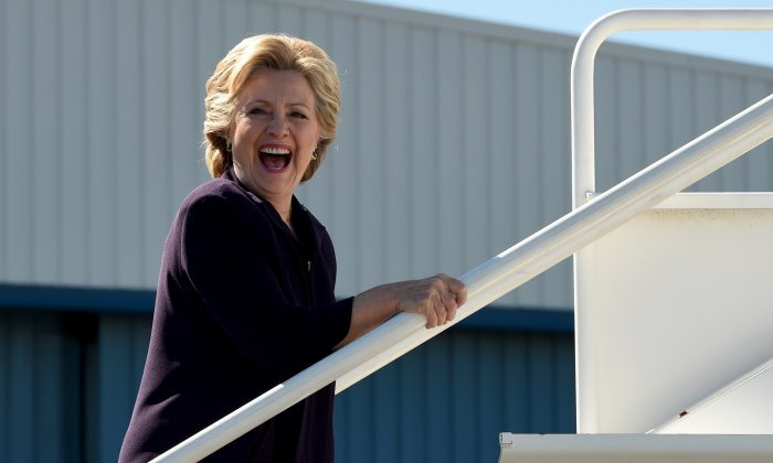 Democrat presidential nominee Hillary Clinton boards her campaign plane in White Plains, New York October 10, 2016. (Timothy A. Clary/AFP/Getty Images)