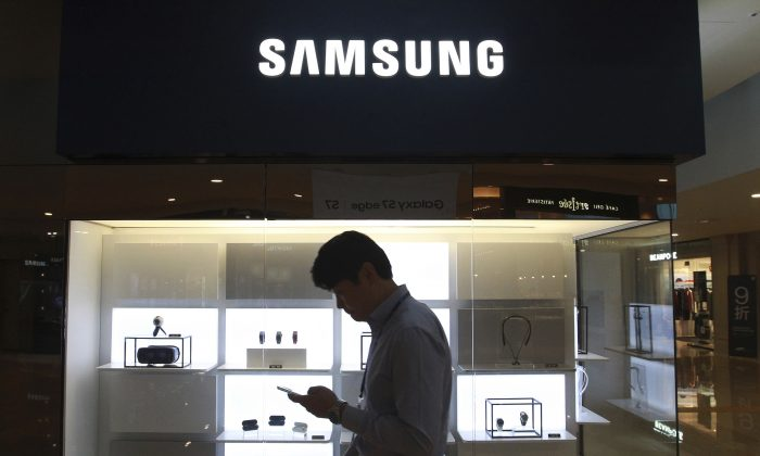 A man passes by a Samsung Electronics shop in Seoul, South Korea, on Oct. 12, 2016. (Ahn Young-joon/AP Photo)