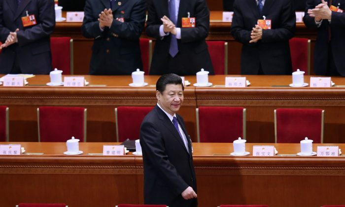Chinese leader Xi Jinping arrives the fifth plenary meeting of the National People's Congress at the Great Hall of the People on March 15, 2013 in Beijing, China. (Feng Li/Getty Images)
