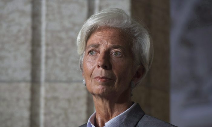 Christine Lagarde, managing director of the International Monetary Fund, listens to a question during a news conference with Prime Minister Justin Trudeau in Ottawa on Sept. 13, 2016. Lagarde strongly advocates a greater role for women in business to improve economic growth. (The Canadian Press/Adrian Wyld)