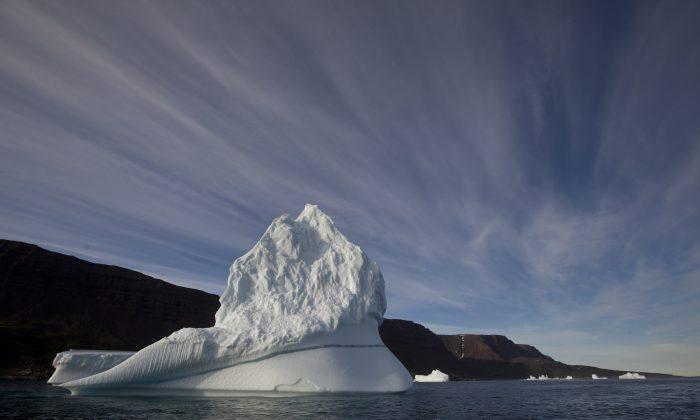 A iceberg floats in the sea near Qeqertarsuaq, Disko Island, Greenland, on July 21, 2011. (AP Photo/Brennan Linsley)