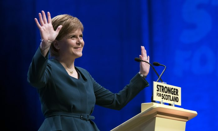 First Minister of Scotland and the leader of the Scottish National Party Nicola Sturgeon, at the start of the SNP's biggest-ever conference, in Glasgow, Scotland, on Oct. 13, 2016. (John Linton/PA via AP)