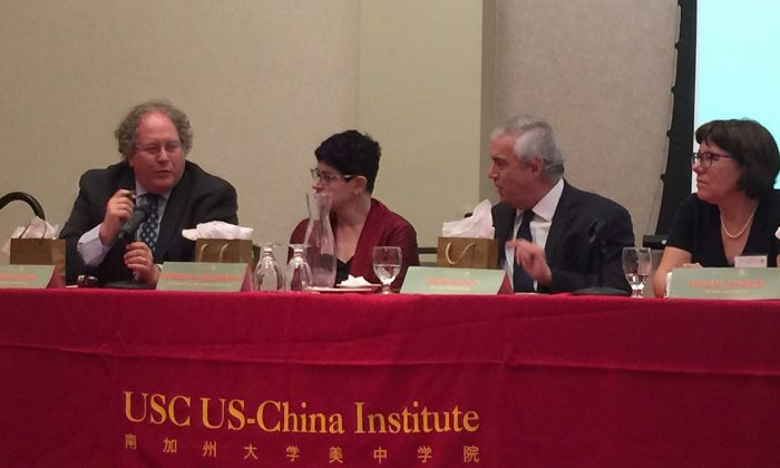 (From Left) Clayton Dube, Director of University of Southern California US-China Center; Deborah Seligsohn, researcher at UCSD; John Kamm, Founder of The Dui Hua Foundation; Susan Finder, Visiting Lecturer at the School of Transnational Law of Peking University, during a panel discussion at a US-China Institute conference in Los Angeles, California, on Sept. 29. (Juliet Zhu/Epoch Times)