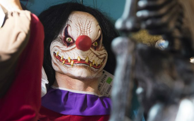 Halloween costumes and props, including a 'scary' clown mask, are seen for sale at Total Party, a party store, in Arlington, Virginia, October 7, 2016. Target removed clown masks from its stores and online retailer two weeks shy of Halloween on Oct. 16. (SAUL LOEB/AFP/Getty Images)