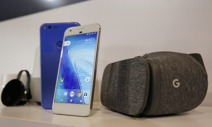 The new Google Pixel phone is displayed next to a Daydream View virtual-reality headset (R) following a Google product event in San Francisco, on Oct. 4, 2016. (AP Photo/Eric Risberg)