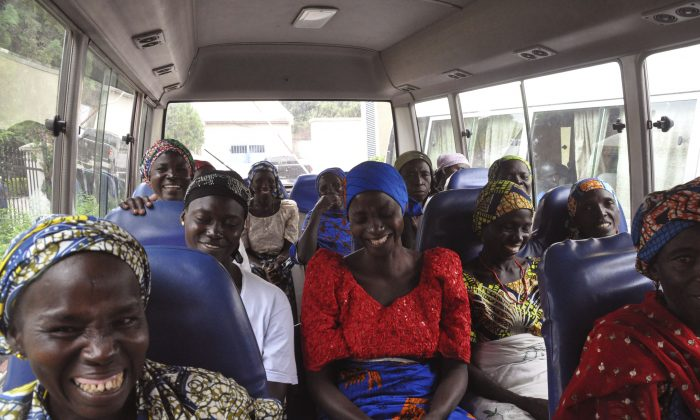 Family members of the Nigerian Chibok kidnapped girls share a moment as they depart to the Nigerian minister of women affairs in Abuja, Nigeria, on Oct. 18, 2016. (AP Photo/Olamikan Gbemiga)