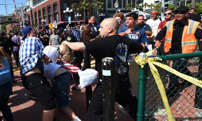 Protesters and supporters of Republican presidential nominee Donald Trump fight during a rally outside Trump's event in San Diego, California, on May 27, 2016.  (Mark Ralston/AFP/Getty Images)