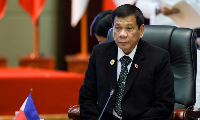 Philippine President Rodrigo Duterte attends the ASEAN Summit Retreat during the second day of the Association of Southeast Asian Nations (ASEAN) Summit in Vientiane, Laos on Sept. 7, 2016. (YE AUNG THU/AFP/Getty Images)