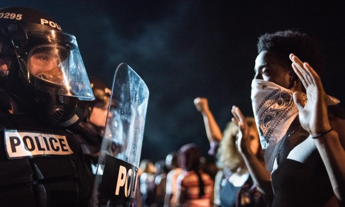 Police officers face off with protesters on the I-85 in Charlotte, N.C., on Sept. 21, 2016. (Sean Rayford/Getty Images)