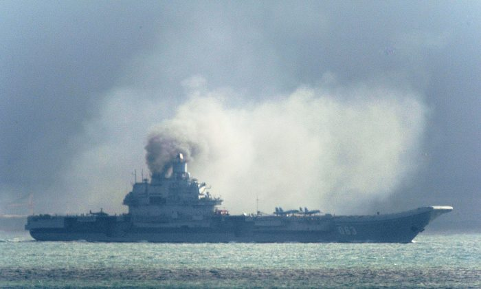 The Russian aircraft carrier Admiral Kuznetsov passes within a few miles of Dover, in the southeast of England as a fleet of Russian warships sail through the North Sea, and the English Channel Friday, on Oct. 21, 2016. (Gareth Fuller/PA Wire)