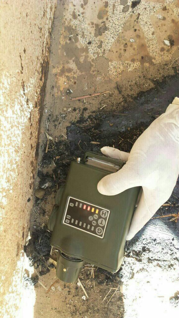 A device used to detect harmful chemicals shows a positive reading for a blister agent near an ISIS weapons cache captured in Qayarah, Iraq. (Ed Alexander/BLACKOPS Cyber)
