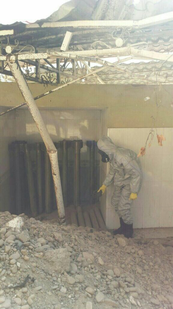 A man in a protective suit investigates a chemical weapons cache, captured in mid-October from ISIS in Qayarah, Iraq. (Ed Alexander/BLACKOPS Cyber)