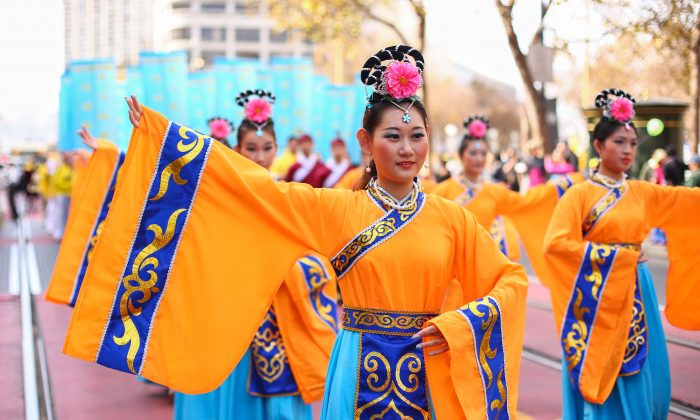 Over 5,000 practitioners and supporters of Falun Gong march in a parade in San Francisco on Oct. 22, 2016, bringing awareness to the practice and calling an end to the persecution in China that started on July 20, 1999. (Benjamin Chasteen/Epoch Times)