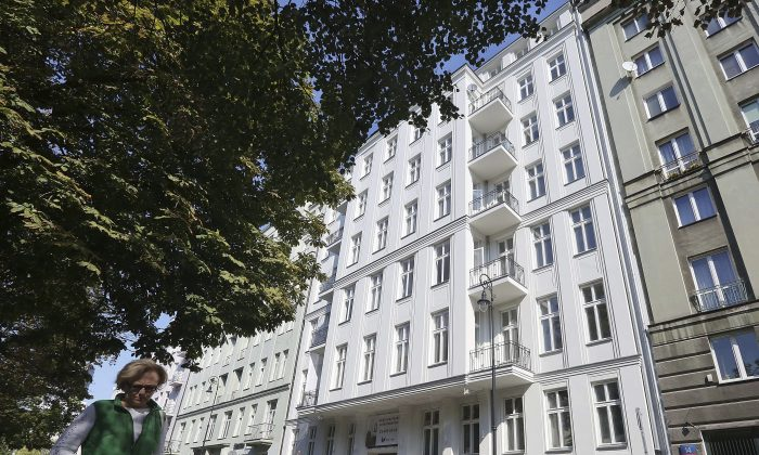 An apartment building freshly renovated by an international developer group that bought the house from the husband of Warsaw Mayor Hanna Gronkiewicz-Waltz, in Warsaw, Poland, on Sept. 19, 2016. Its previous ownership rights and its restitution to the Waltz family are one of the issues raised amid a current political storm. (AP Photo/Czarek Sokolowski)