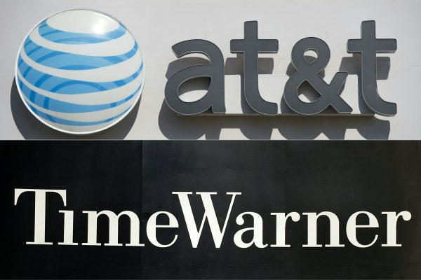 An AT&T logo at a cellphone store in Springfield, Va., on Oct. 23, 2014, and the Time Warner company logo on the front of the headquarters building in New York on Nov. 24, 2003. (Saul Loeb; Stan Honda/AFP/Getty Images)