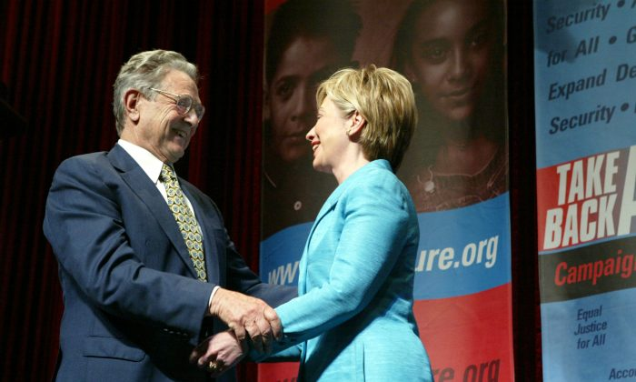 Philanthropist George Soros greets U.S. Senator Hillary Clinton (D-NY) after she introduced him at the Take Back America Conference in Washington  on June 3, 2004. (Matthew Cavanaugh/Getty Images)