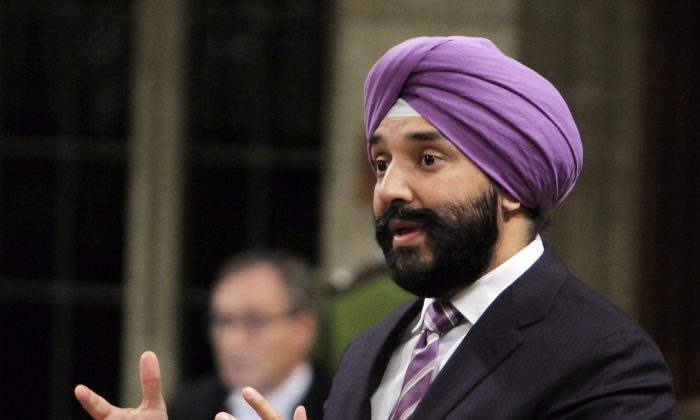 Navdeep Bains, Minister of Innovation, Science and Economic Development, stands in the House of Commons during question period in Ottawa on Oct. 21. (The Canadian Press/Fred Chartrand)
