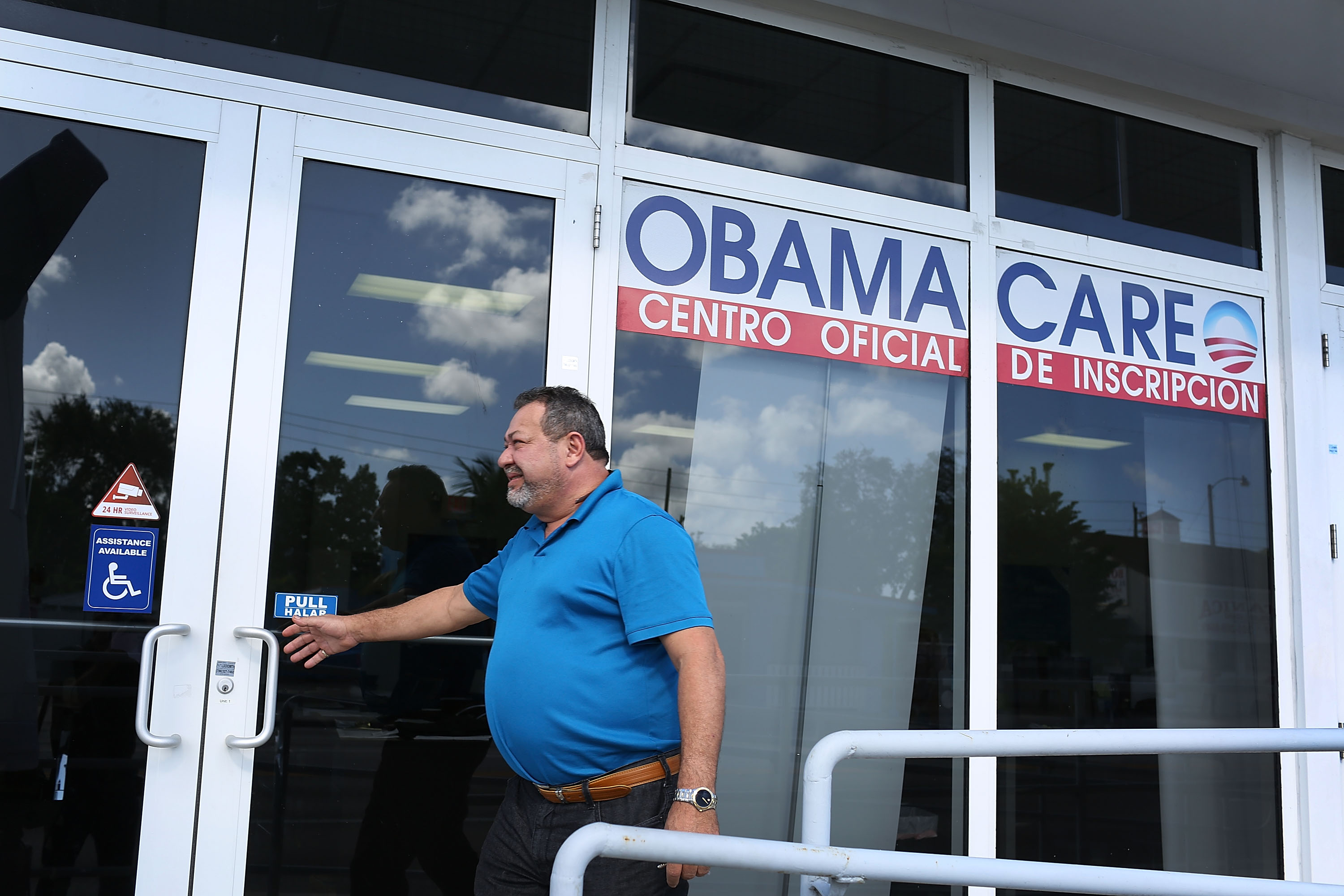 A person walks into the UniVista Insurance company office where people are signing up for health care plans under the Affordable Care Act, also known as Obamacare, in Miami on Dec. 15, 2015. (Joe Raedle/Getty Images)