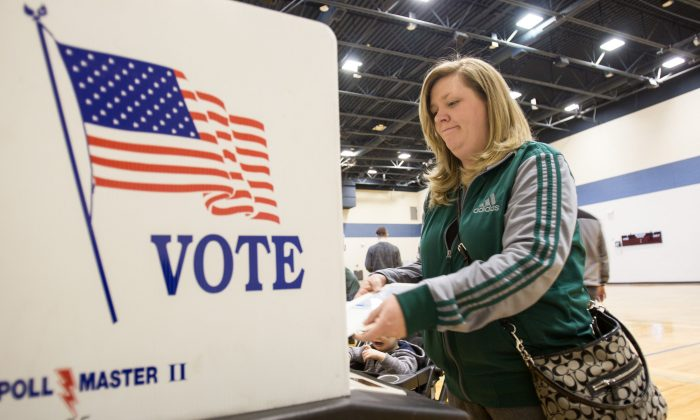 A woman casts her ballot for the Michigan presidential primary at a polling station in Warren, Mich., on March 8, 2016. (GEOFF ROBINS/AFP/Getty Images)