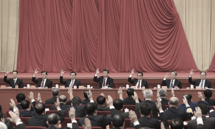 Chinese leader Xi Jinping (C) and other members of the Politburo Standing Committee attend the Sixth Plenary Session of the 18th Central Committee in Beijing on Oct. 27, 2016. (Li Xueren/Xinhua via AP)