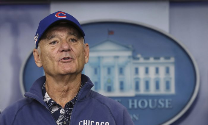 Actor Bill Murray sporting a Chicago Cubs jacket and cap during a brief visit in the Brady Press Briefing Room of the White House in Washington in this Oct. 21, 2016, file photo. MLB.com reports Murray gave a ticketless fellow Cubs fan an extra seat to Game 6 of the World Series on Nov. 1, 2016. (AP Photo/Manuel Balce Ceneta, File)