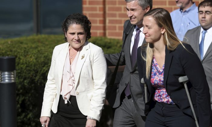 University of Virginia administrator Nicole Eramo, left, leaves the federal courthouse in Charlottesville, Va., with attorney Libby Locke, right, on Friday, Nov. 4, 2016.  A federal jury on Friday found Rolling Stone magazine, its publisher and a reporter defamed Eramo in a discredited story about gang rape at a fraternity house of the university.   (Ryan M. Kelly /The Daily Progress via AP)