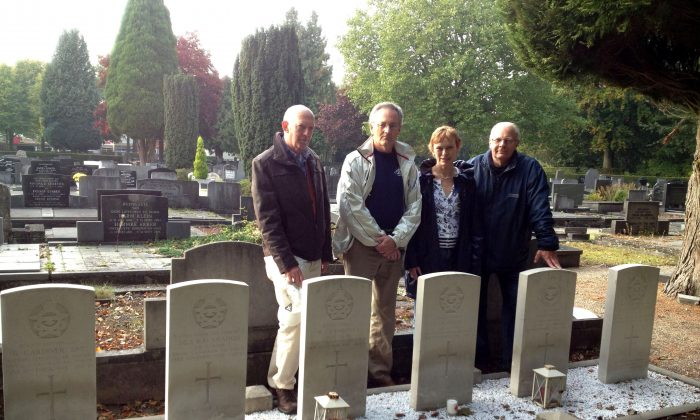 Don Odell (2nd L) during his visit to Ter Apel, Netherlands, where the six RCAF aircrew, including his uncle, were buried after their plane was shot down during the Second World War. With him are the organizers of a memorial ceremony held in November 2013 on the 70th anniversary of the downing of the plane. (Courtesy of Don Odell)