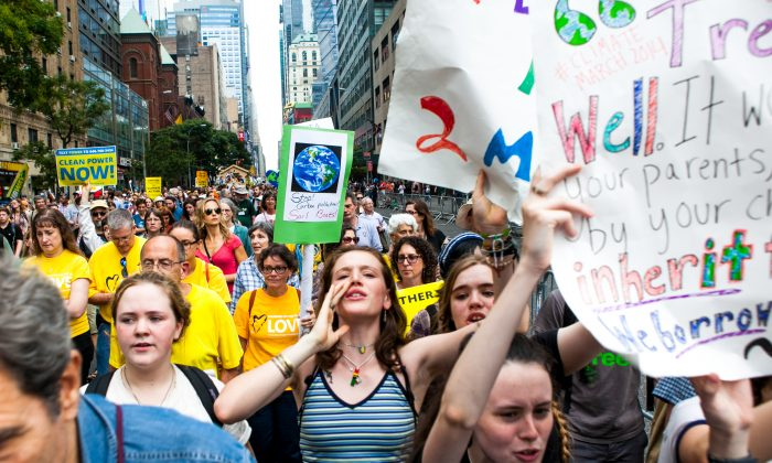 More than 300,000 people take part in the People's Climate Change march, considered to be the largest climate change march in history, in New York on Sept. 21, 2014. The emphasis on sustainability on college campuses. (Samira Bouaou/Epoch Times)